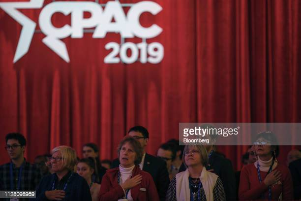 Attendees stand for the Pledge of Allegiance during the Conservative Political Action Conference in National Harbor Maryland US on Thursday Feb 28...