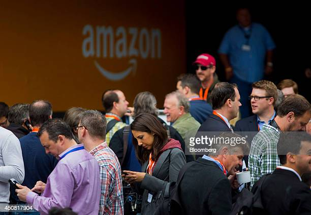 Attendees stand in line before the start of an Amazoncom Inc event at Fremont Studios in Seattle Washington US on Wednesday June 18 2014 Amazoncom...