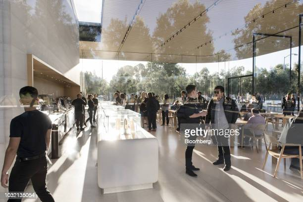 Attendees stand in the Apple Visitors Center at the Steve Jobs Theater ahead of an Apple Inc event in Cupertino California US on Wednesday Sept 12...