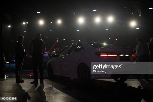 Attendees stand near the new2018 Toyota Motor Corp. Corolla vehicle during the company's launch event in Sao Paulo, Brazil, on Thursday, March 16,...