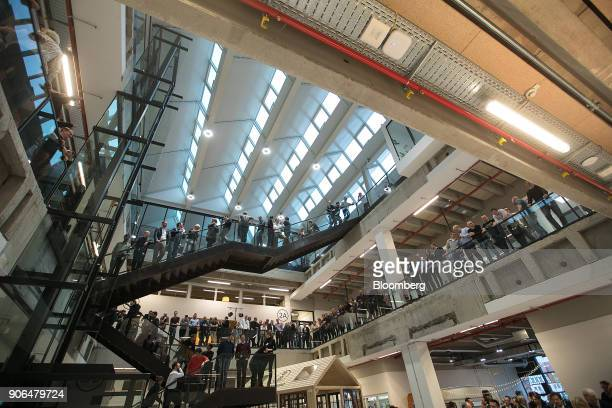 Attendees stand on staircases and balconies during the opening of the Robert Bosch GmbH Internet of Things campus in Berlin Germany on Thursday Jan...