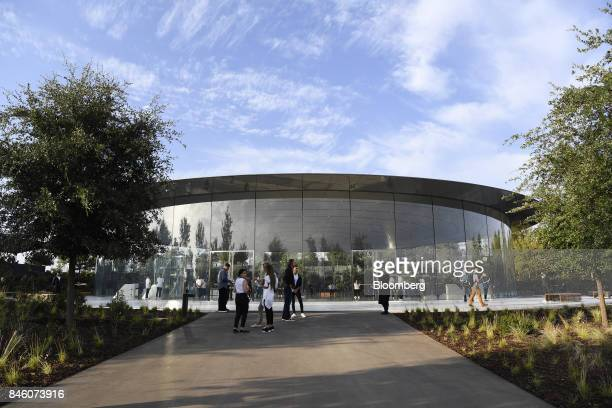Attendees stand outside the Steve Jobs Theater ahead of an event in Cupertino California US on Tuesday Sept 12 2017 Apple plans to unveil three...