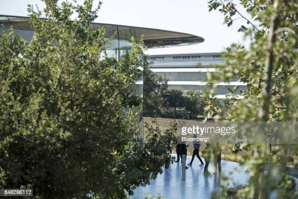 Attendees stand outside the Steve Jobs Theater on the Apple Inc campus after an event in Cupertino California US on Tuesday Sept 12 2017 Apple...