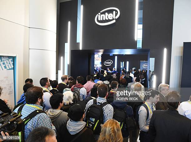 Attendees stream into the Intel stand in the Las Vegas Convention Center as the doors open for the first day of the 2015 Consumer Electronics Show...