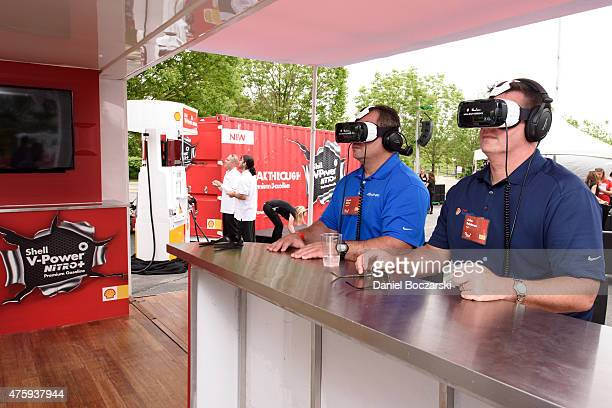 Attendees take a 3D engine journey with the Oculus Riftpowered Gear VR headset at Soldier Field at the Shell VPower NiTRO Premium Gasoline event on...