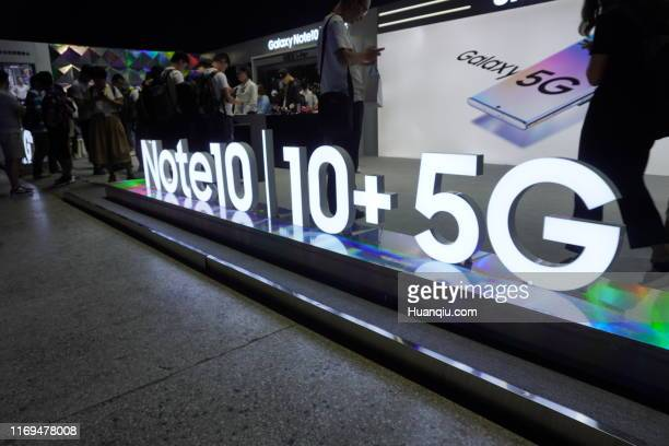Attendees take a look during the launch event of the 5G smartphone Galaxy Note 10 at Dongyi International Media Industrial Park on August 21, 2019 in...