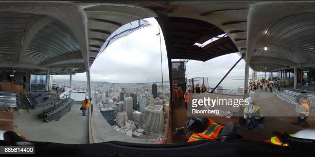 Attendees take a tour during a topping off ceremony for the Salesforce Tower in San Francisco California US on Thursday April 6 2017 The Salesforce...