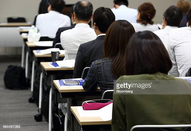 Attendees take part in a class at the Financial Academy in Tokyo Japan on Thursday May 8 2014 When Chiho Higo a lecturer at Tokyo's Financial Academy...
