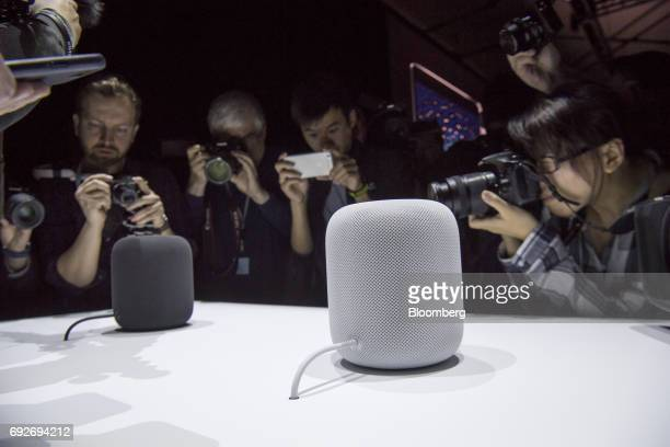 Attendees take photographs of the Apple Inc HomePod speakers on display during the Apple Worldwide Developers Conference in San Jose California US on...