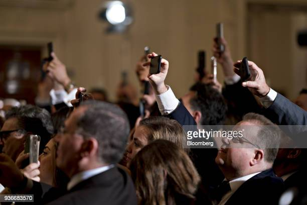 Attendees take photographs with their mobile phones as US President Donald Trump not pictured arrives to speak during a Greek Independence Day...