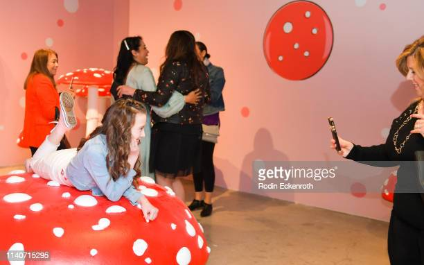 Attendees take pictures at WonderWorld Hollywood and Experience PopUp Opening Night Party on April 05 2019 in Hollywood California