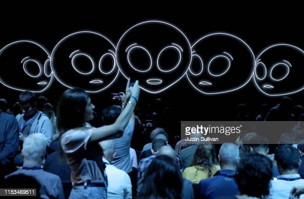 Attendees take pictures before the start of the 2019 Apple Worldwide Developer Conference at the San Jose Convention Center on June 03 2019 in San...