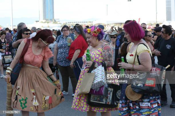 Attendees talk about clothing during the Viva Las Vegas Rockabilly Weekend's car show at the Orleans Arena on April 20 2019 in Las Vegas Nevada