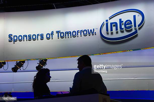 Attendees talk with each other at the Intel Corp booth at the 2013 Consumer Electronics Show in Las Vegas Nevada US on Wednesday Jan 9 2013 The 2013...