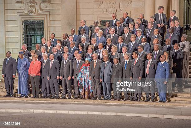 Attendees to the Valetta Summit on Migration are seen line up for a group photo during the opening ceremony at Auberge de Castille te Valletta. The...
