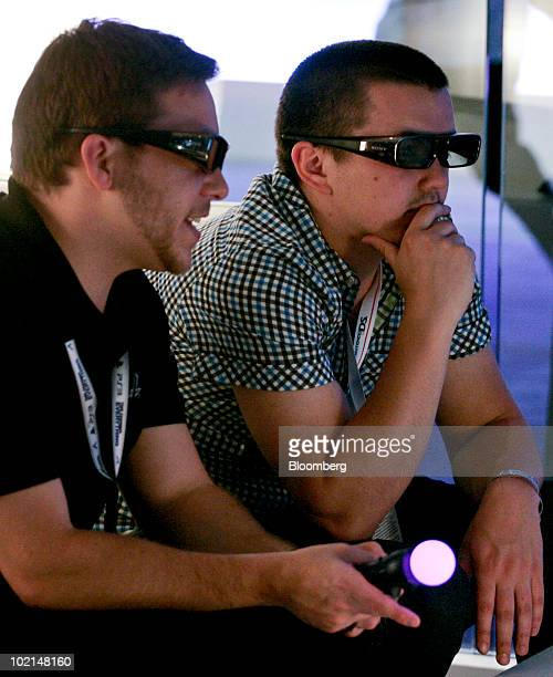 Attendees try out a Sony PlayStation Move motion-activated controllers as they play a 3-D game at the Electronic Entertainment Expo in Los Angeles,...