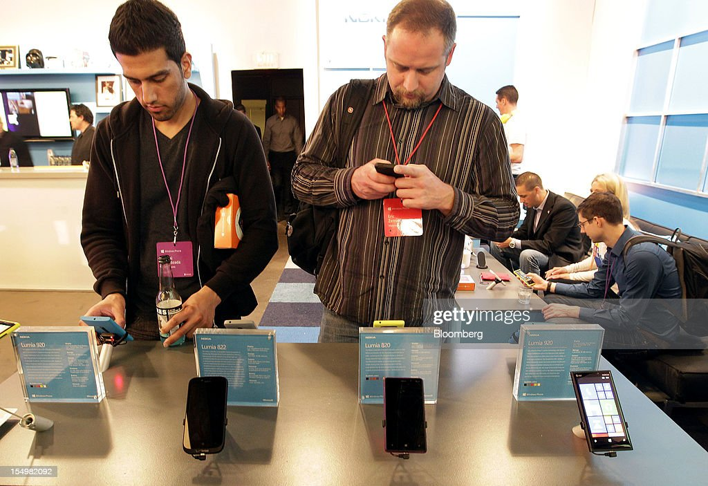 Attendees try out Microsoft Corp.'s Windows Phone 8 operating system at an event in San Francisco, California, U.S., on Monday, Oct. 29, 2012. Microsoft Corp. unveiled a new version of its software for smartphones today, redoubling an effort to regain market share lost to Apple Inc. and Google Inc. Photographer: Tony Avelar/Bloomberg via Getty Images