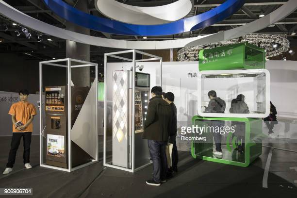 Attendees try out vending machines that work with WeChat Pay at Tencent Holdings Ltd's WeChat Open Class Pro conference in Guangzhou China on Monday...