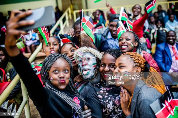Attendees use a smartphone to take a selfie photograph during the independence celebrations on Jamhuri Day at Kasarani stadium in Nairobi Kenya on...