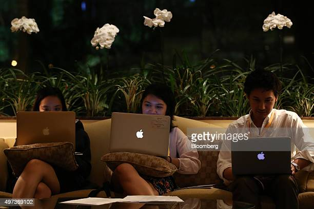 Attendees use Apple Inc laptop computers at the AsiaPacific Economic Cooperation CEO Summit in Manila the Philippines on Monday Nov 16 2015 With...