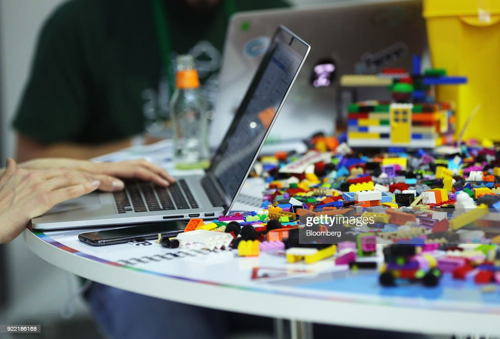 Attendees use laptop computers as Lego A/S toybricks sit on a desk in the Hackathon area at the Bosch Internet of Things (IoT) conference, in Berlin, Germany, on Wednesday, Feb. 21, 2018. Bosch raked in record profit and revenue last year and foresees more growth in 2018 even as the German auto-parts giant wrestles with weakness in the scandal-beset diesel segment that might be compounded by controversial air-quality tests on monkeys. Photographer: Krisztian Bocsi/Bloomberg via Getty Images