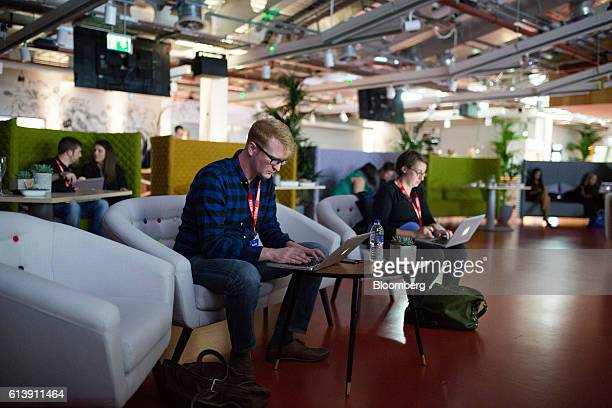 Attendees use laptop computers during the global launch event of 'Workplace' at the Facebook Inc offices in London UK on Monday Oct 10 2016 Workplace...