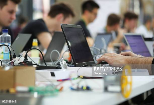 Attendees use laptop computers in the Hackathon area at the Bosch Internet of Things conference in Berlin Germany on Wednesday Feb 21 2018 Bosch...