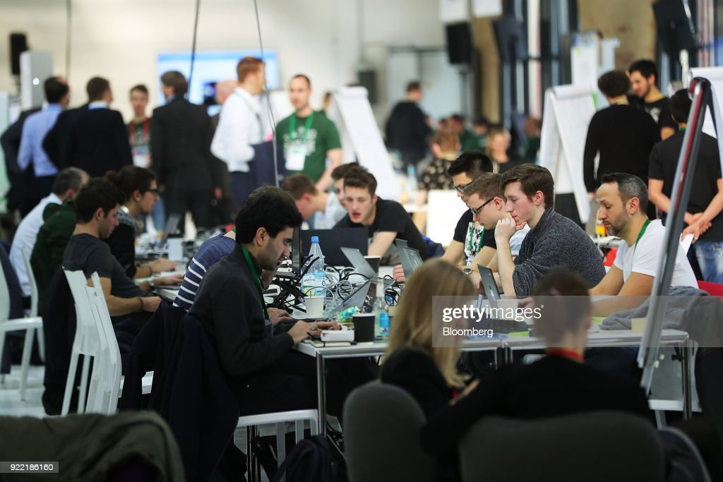 Attendees use laptop computers in the Hackathon area at the Bosch Internet of Things (IoT) conference, in Berlin, Germany, on Wednesday, Feb. 21, 2018. Bosch raked in record profit and revenue last year and foresees more growth in 2018 even as the German auto-parts giant wrestles with weakness in the scandal-beset diesel segment that might be compounded by controversial air-quality tests on monkeys. Photographer: Krisztian Bocsi/Bloomberg via Getty Images