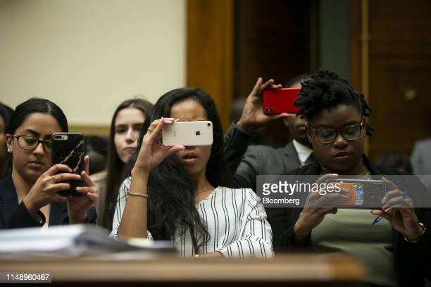 Attendees use smartphone devices to take photographs and video during a hearing on lessons from the Mueller report in Washington DC US on Monday June...