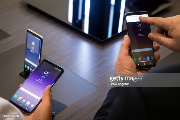 Attendees use the new Samsung Galaxy S8 at the launch event March 29 2017 in New York City Following the recall and discontinuation of the Samsung...