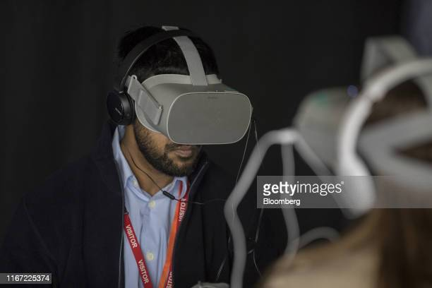 Attendees uses virtual reality headsets showing imaging equipment in operation during a BP Plc immersive technology event at the company's...