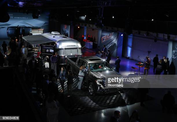 Attendees view a General Motors Co 2019 GMC Sierra SLT truck hitched to an Airstream trailer during an event at Russell Industrial Complex in Detroit...