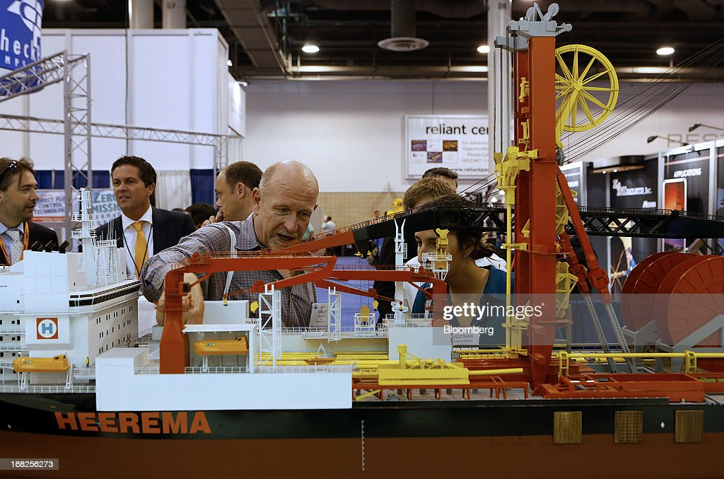 Attendees view a model of Heerema Group's AEGIR ship during the 2013 Offshore Technology Conference (OTC) in Houston, Texas, U.S., on Tuesday, May 7, 2013. The Offshore Technology Conference (OTC) is organized and operated to promote and further the advance of scientific and technical knowledge of offshore resources and environmental matters. Photographer: Aaron M. Sprecher/Bloomberg via Getty Images
