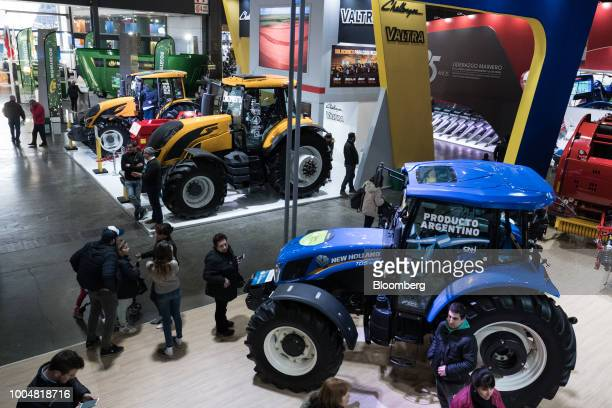 Attendees view a New Holland Agricultural Equipment SpA TD5 tractor at the exhibition pavilion during La Exposicion Rural agricultural and livestock...
