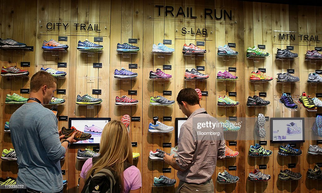 Attendees view Salomon shoes at the company's booth during the Outdoor Retailer Summer Market show in Salt Lake City, Utah, U.S., on Thursday, Aug. 1, 2013. Consumer spending in the U.S. rose in line with forecasts in June as Americans' incomes grew, a sign the biggest part of the economy is withstanding fiscal headwinds. Photographer: George Frey/Bloomberg via Getty Images