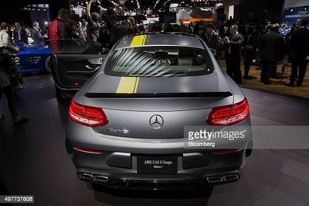 Attendees view the 2017 Daimler AG MercedesBenz AMG C63 S Coupe performance vehicle during the Los Angeles Auto Show in Los Angeles California US on...