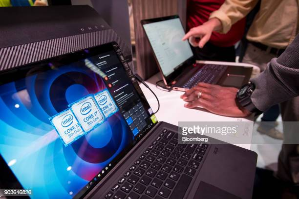 Attendees view the Acer Inc Switch 7 laptop computer powered by the Intel Corp i7 processor at the company's booth during the 2018 Consumer...