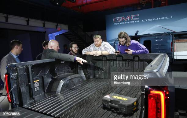 Attendees view the CarbonPro carbon fiber pickup box on the General Motors Co 2019 GMC Sierra Denali truck during an event at Russell Industrial...