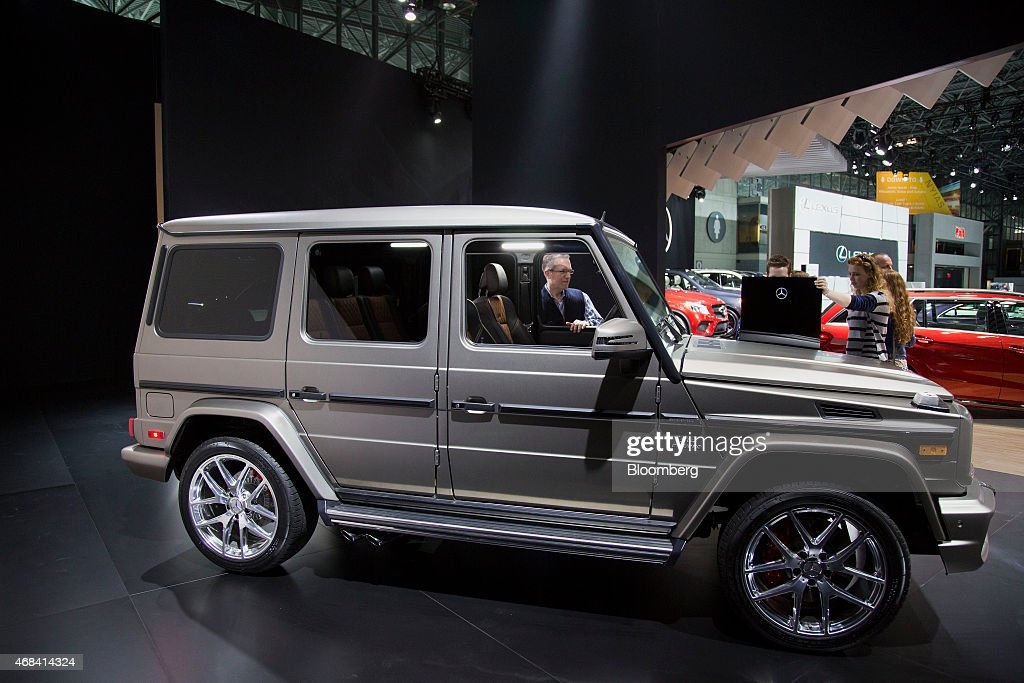 Attendees view the Daimler AG Mercedes-Benz G65 AMG vehicle during the 2015 New York International Auto Show in New York, U.S., on Thursday, April 2, 2015. The 115th New York International Auto Show, which runs from April 3-12, will reveal 60 plus cars and trucks as well as host a wide range of industry events attracting automobile executives and members of the media from around the world. Photographer: Michael Nagle/Bloomberg via Getty Images
