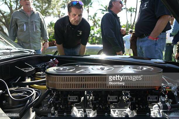 Attendees view the engine of a 1961 Ferrari SpA 250 GT SWB sports vehicle during the 26th Annual Cavallino Classic Event at the Breakers Hotel in...
