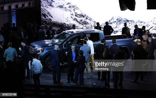 Attendees view the General Motors Co 2019 GMC Sierra Denali truck during an event at Russell Industrial Complex in Detroit Michigan US on Thursday...