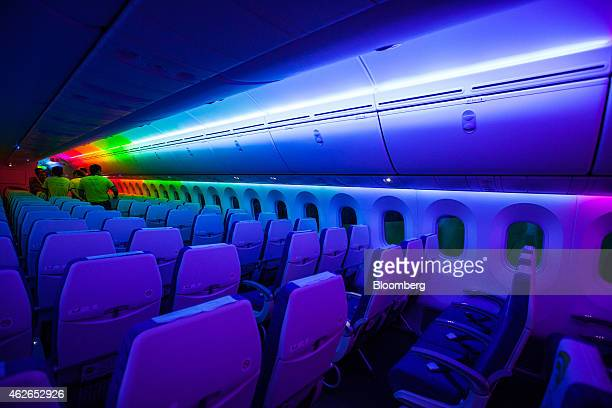 Attendees view the interior of a Boeing Co 787 Dreamliner aircraft operated by Scoot Pte a unit of Singapore Airlines Ltd during a media tour at...