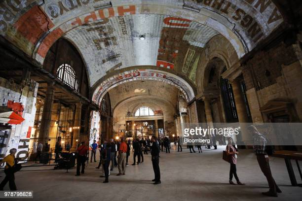 Attendees view the interior of the Michigan Central Station during a Ford Motor Co event in the Corktown neighborhood of Detroit Michigan US on...