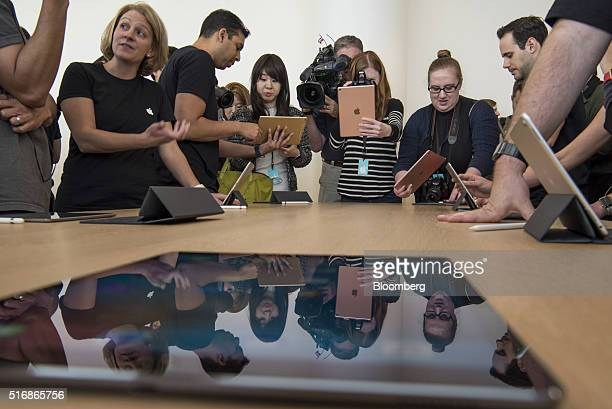 Attendees view the new Apple Inc 97 inch iPad Pro tablet computer after an event in Cupertino California US on Monday March 21 2016 Apple Inc...