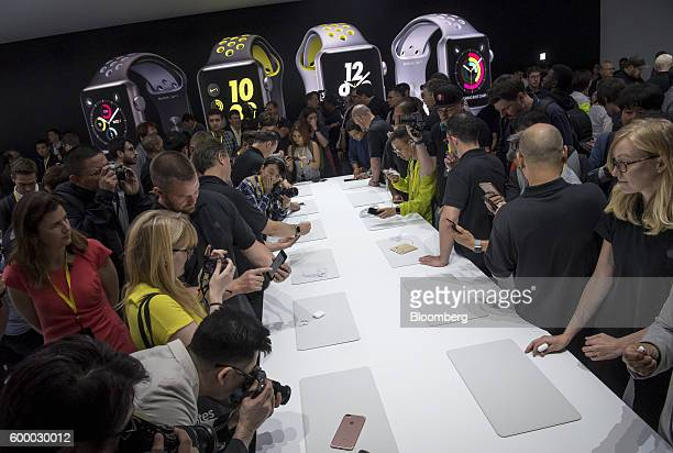 Attendees view the new Apple iPhone 7 and 7 Plus during an event in San Francisco California US on Wednesday Sept 7 2016 Apple Inc unveiled new...