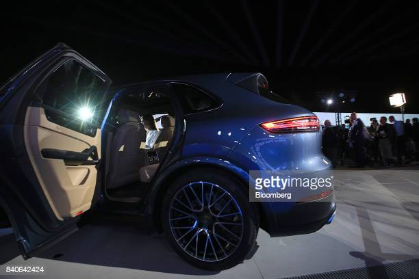 Attendees view the new Porsche AG Cayenne sport utility vehicle as it is unveiled during a launch event in Stuttgart Germany on Tuesday Aug 29 2017...