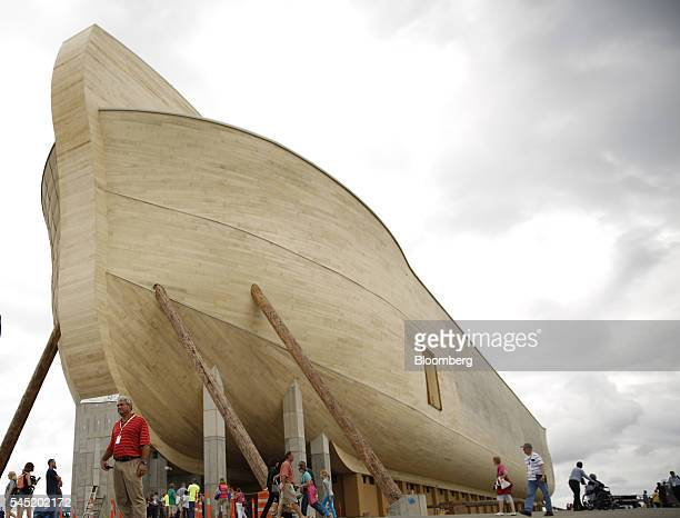 Attendees view the Noah's Ark replica during a VIP and media preview day at the Ark Encounter theme park in Williamstown Kentucky US on Tuesday July...