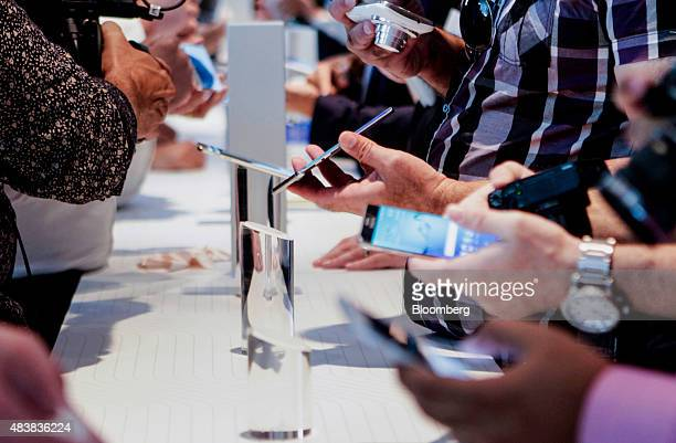 Attendees view the Samsung Electronics Co Galaxy S6 Edge Plus smartphones on display during the Samsung Unpacked 2015 event in New York US on...