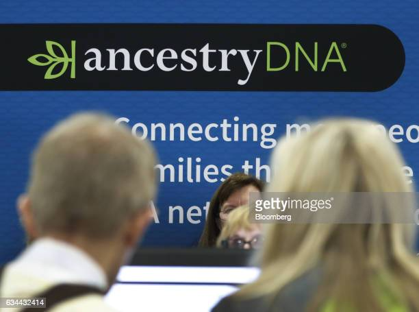 Attendees views the Ancestrycom Inc booth on the exhibition floor of the 2017 RootsTech Conference in Salt Lake City Utah US on Thursday Feb 9 2017...