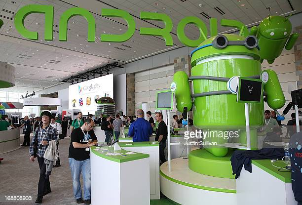 Attendees visit the Android booth during the Google I/O developers conference at the Moscone Center on May 15 2013 in San Francisco California...
